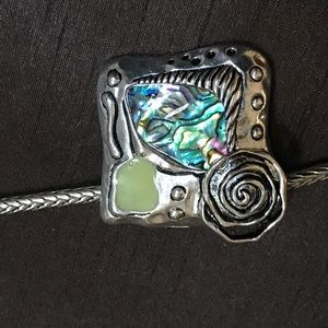 Abalone and silver plated brooch w/ Slide chain.